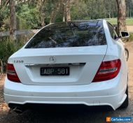 Immaculate Mercedes C250 Coupé. Polar white with red leather. Only 39,000kms.